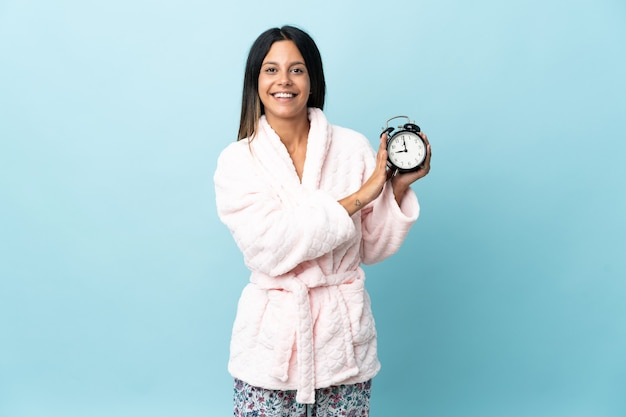 Young girl in pajamas over isolated background