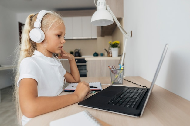Young girl paying attention to online class