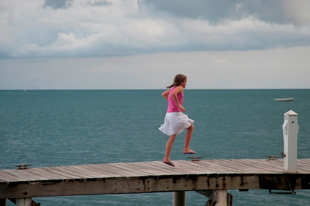 Young girl on a pier at placencia in belize