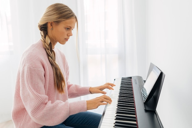 Young girl playing keyboard instrument