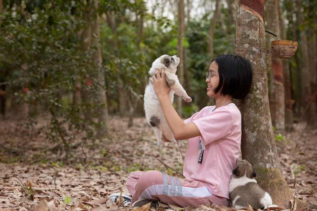 Young girl playing with puppy dog at the park