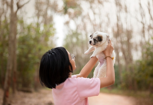 Young girl playing with puppy dog