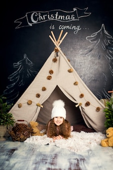 Young girl posing in christmas decorations.