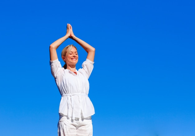 Young girl practicing yoga with copy-space