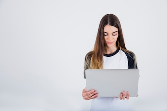 Young girl reading from lap top