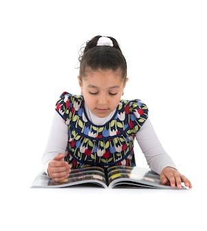 Young girl reading on white background