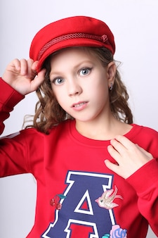 Young girl red cap and jacket, fashionable clothes