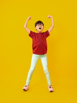 Young girl in red shirt celebrate and raised hands up to success