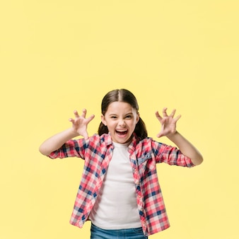 Young girl roaring in studio young