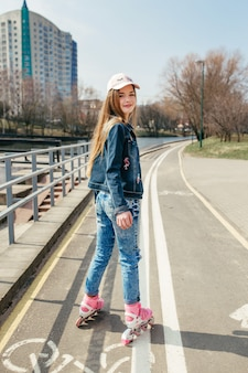 Young girl on rollerblades in the city