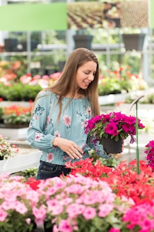 Young girl selecting petunias to purchase