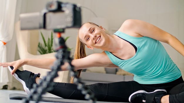 Young girl shooting her fitness videoblog young girl conduct remote teaching to training online