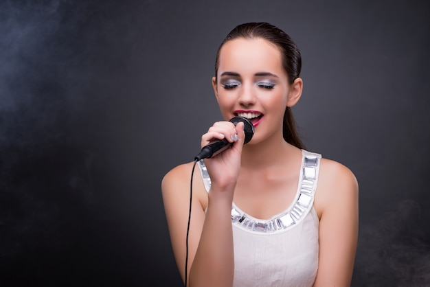 Young girl singing in karaoke club