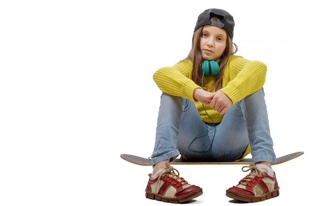 Young girl sitting on skate