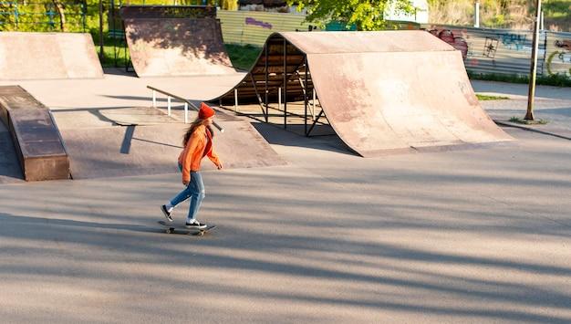 Young girl skating outdoors