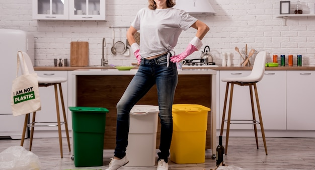Young girl sorting garbage at the kitchen. concept of recycling. zero waste