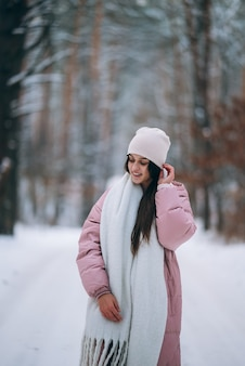 Young girl standing in the middle of snowy road