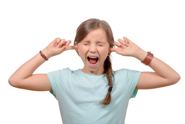 Young girl stops his ears with his hands and closes his eyes