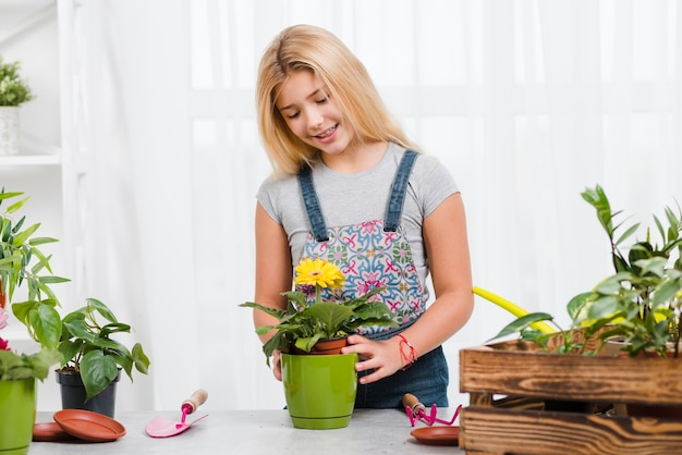 Young girl taking care of flowers