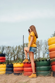 Young girl taking pictures with colored tires