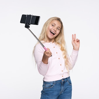 Young girl taking selfies of herself