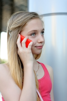 Young girl talking on the phone outdoor