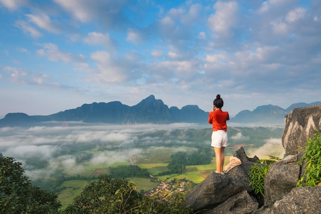 Young girl travels on high mountain in vang-vieng, laos.
