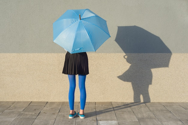 Young girl under umbrella