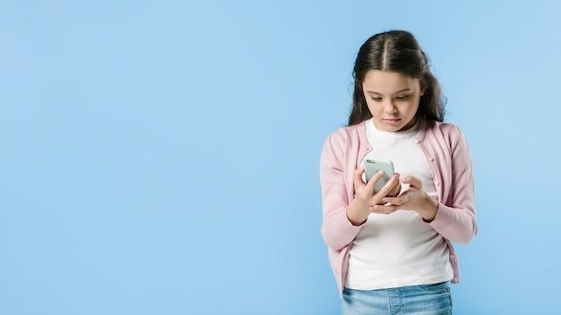 Young girl using phone in studio