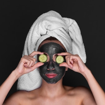 Young girl using skin care treatment