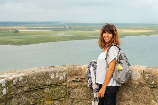 A young girl visiting the famous mont saint-michel abbey from inside, in the manche department, normandy region, france