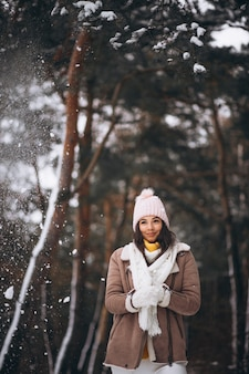 Young girl walking in winter park