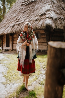 Young girl walks in the village in a traditional ukrainian dress