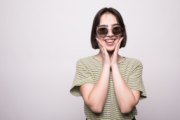 Young girl wearing sunglasses isolated. closeup portrait