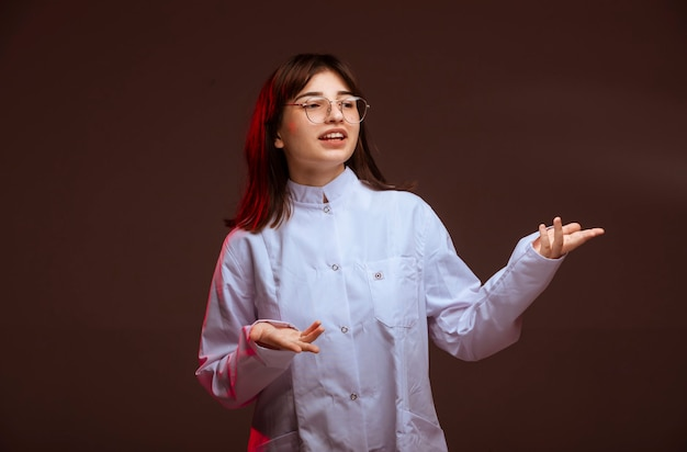 Young girl in white shirt making presentation.