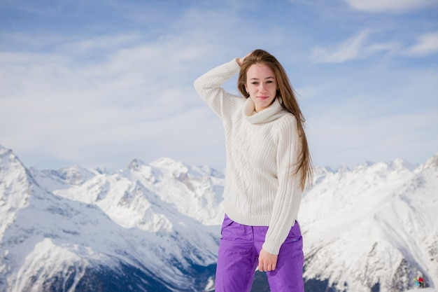 Young girl in a winter natural landscape