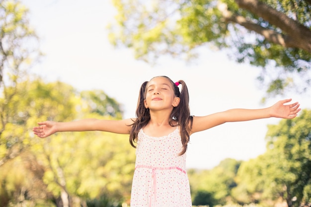 Young girl with arms outstretched