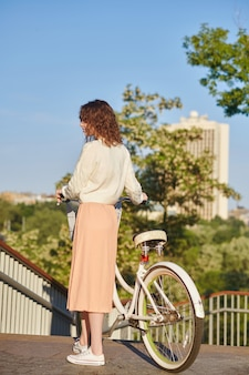 A young girl with a bike enjoying a morning