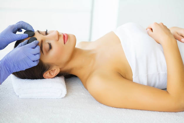 Young girl with clean skin in spa salon.