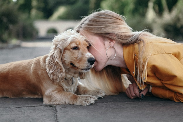 Young girl with dog at the park