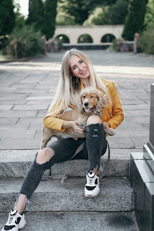 Young girl with dog walks in the park