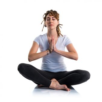 Young girl with dreadlocks doing yoga