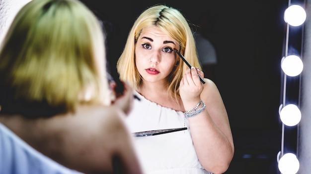 Young girl with eye shadow