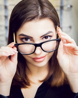 Young girl with glasses on the light.
