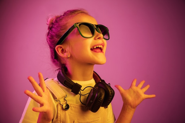 Young girl with headphones enjoying music