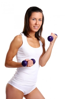 Young girl with lift weights on white