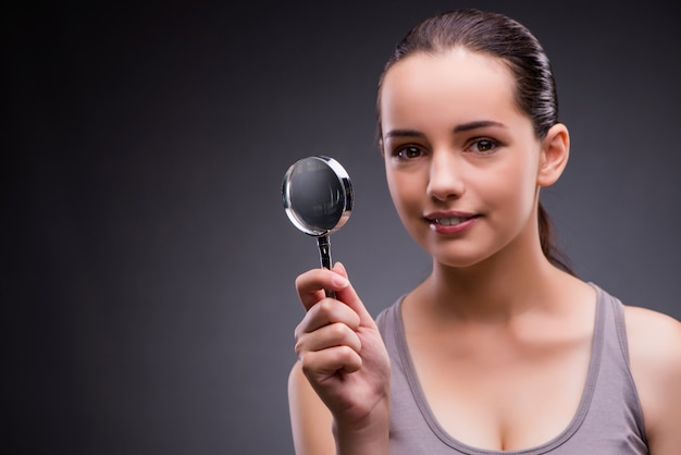 Young girl with magnifying glass