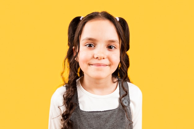 Young girl with pigtails hairstyle posing