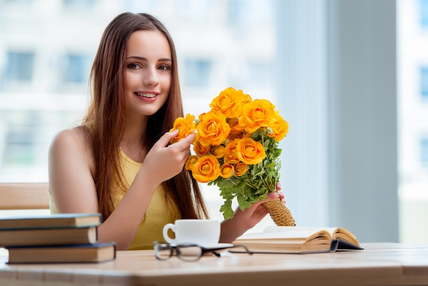 Young girl with present of flowers