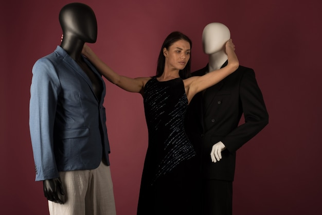 A young girl with problematic skin suffers from loneliness in a society of stylish manikins on ruby space.